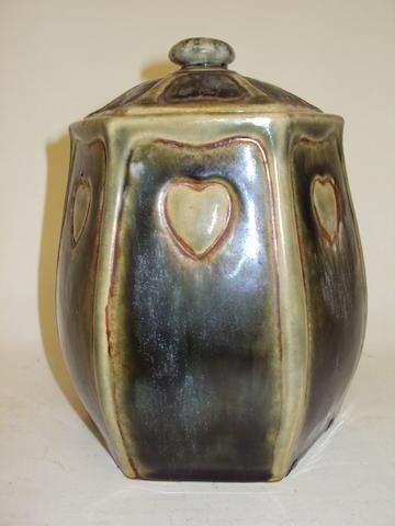 A hexagonal Royal Doulton Lambeth tobacco jar and cover