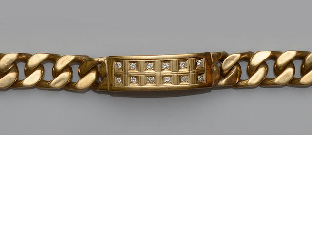 A gentleman's 9ct gold diamond set bracelet