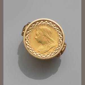 A collection of 9ct gold mounted half sovereign rings (4)