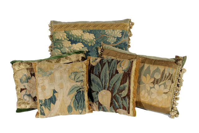 Seven cushions featuring 17th century tapestry fragments