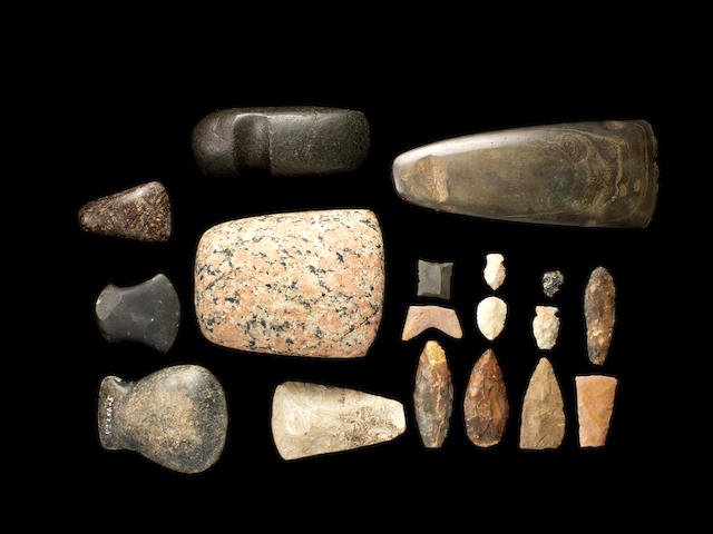 Seven Egyptian stone axe heads and eleven flint implements, 18