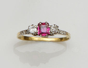 An emerald and diamond three stone ring and a ruby and diamond ring  (2)