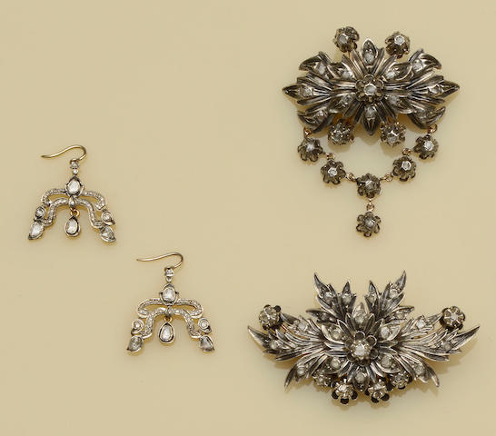 Two diamond set brooches and pair of diamond earpendants (3)