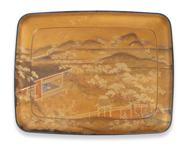"A Japanese rectangular gold lacquered tray depicting an extensive landscape, 13 1/4"" x 10 1/4""."