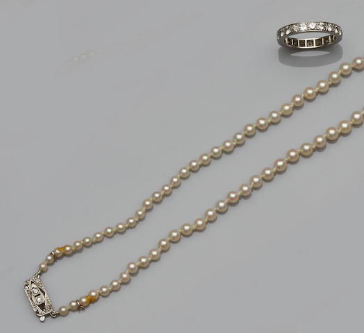 A diamond full hoop eternity ring and a cultured pearl necklace  (2)