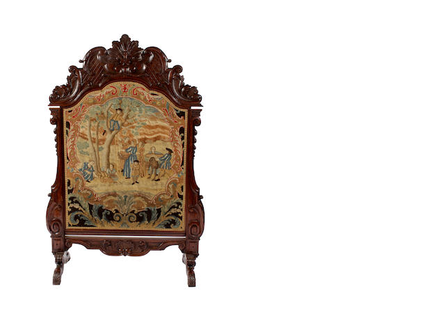 A 19th century French carved walnut adjustable firescreen