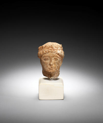 A Cypriot limestone votive head