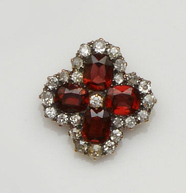 A garnet and diamond brooch