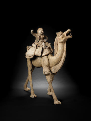A fine and large unglazed grey pottery camel and rider Tang Dynasty