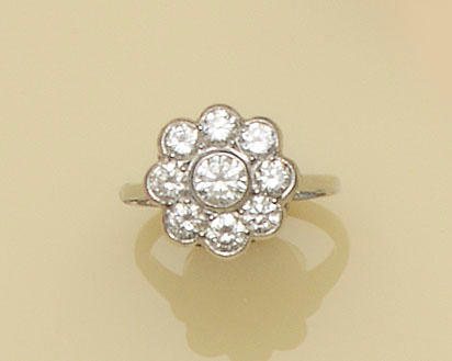A nine stone diamond cluster ring