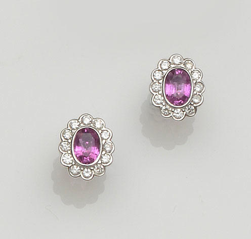 A pair of pink sapphire and diamond oval cluster earstuds