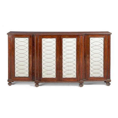 A Regency rosewood breakfront side cabinet  in the manner of Gillows