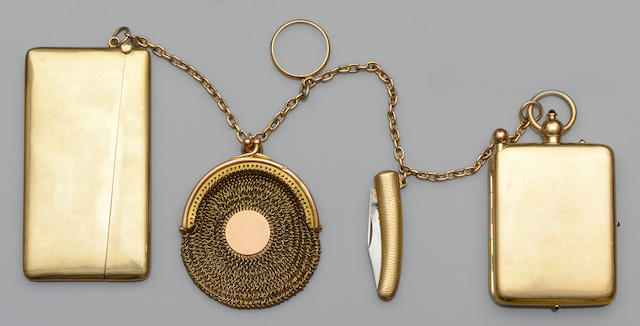 A collection of yellow precious metal accessories