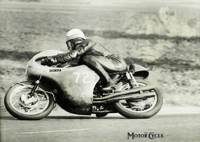 A signed monochrome photo print from The MotorCycle of Mike Hailwood riding the 1964 Honda Four,