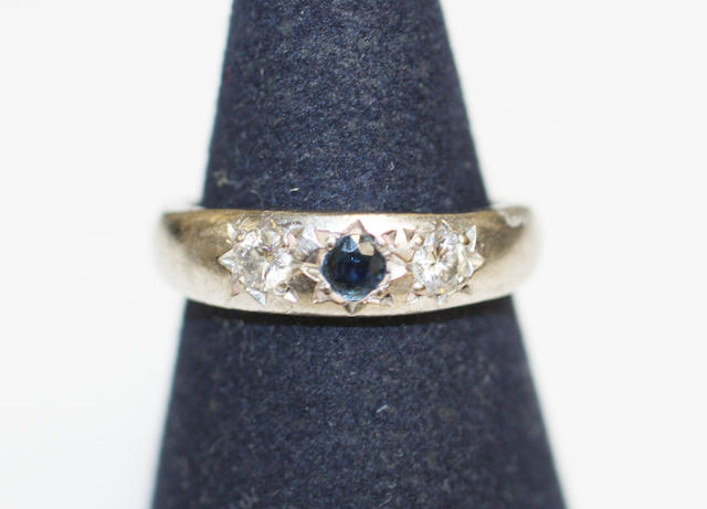 An 18ct white gold diamond and sapphire three stone ring,