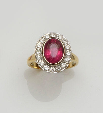 An 18ct gold tourmaline and diamond cluster ring