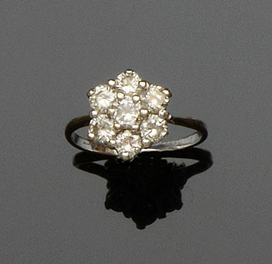 A seven stone diamond cluster ring