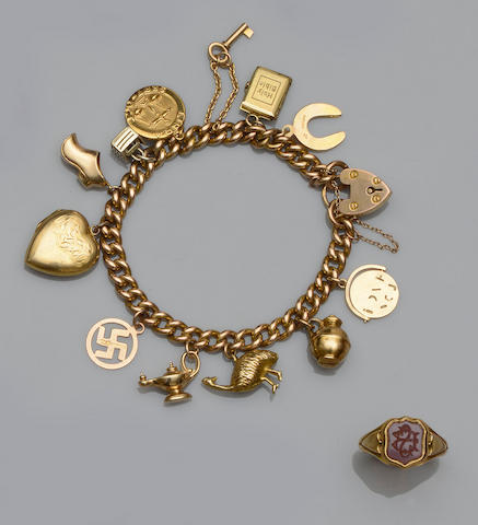 A 9ct gold charm bracelet and a late Victorian signet ring (2)