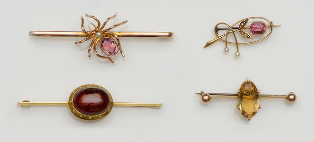 A collection of four gem set bar brooches (4)