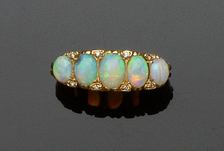 An opal and diamond half hoop ring