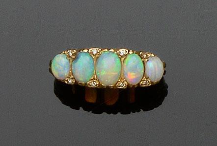An opal and diamond half hoop ring
