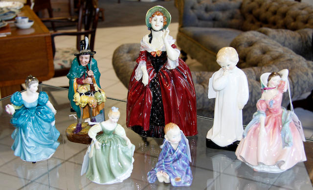 A Collection of seven Royal Doulton Figures