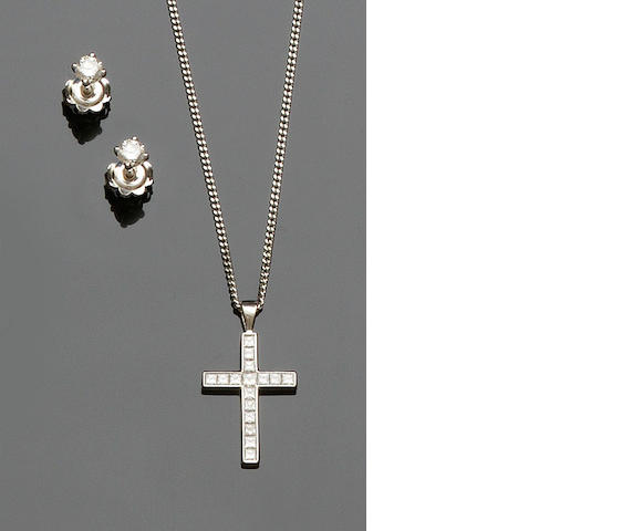 A diamond cross pendant and a pair of diamond earstuds (2)