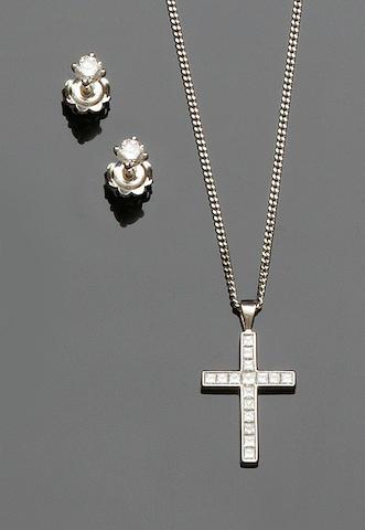 A diamond cross pendant and a pair of diamond earstuds (2)