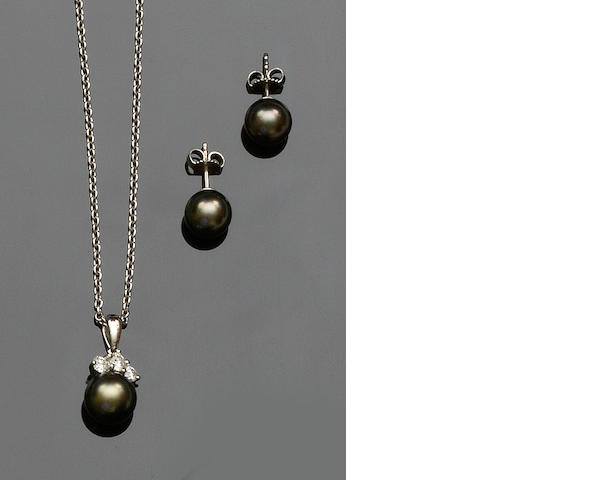 Mikimoto: A cultured pearl and diamond pendant and a pair of cultured pearl earstuds ensuite  (2)