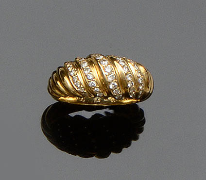 Cartier: An 18ct gold and diamond dress ring