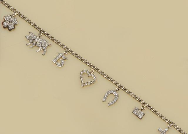 A diamond set charm bracelet