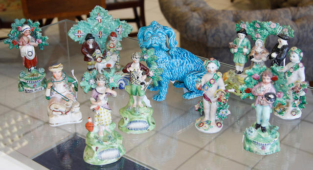 Four Staffordshire pearlware and enamelled figures, a pair of Bow cherubs, a John Rose turquoise glazed dog, a pearlware plate and pepper and three other Staffordshire figures