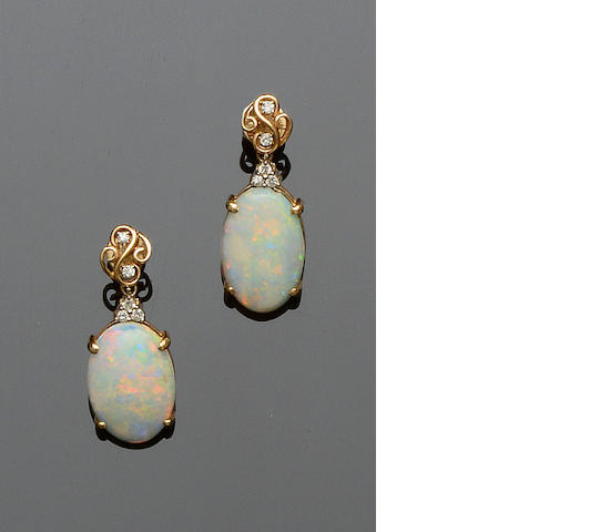A pair of opal and diamond earpendents
