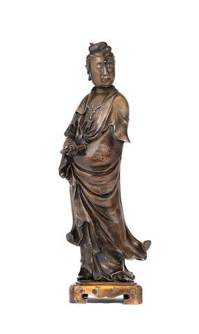 A large silver-inlaid bronze figure of Guanyin 18th century, seal mark Yutang Shisou and Yuanhe ernian