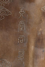 A large silver-inlaid bronze figure of Guanyin 18th century, seal mark Yutang Shisou and Yuanhe ernian