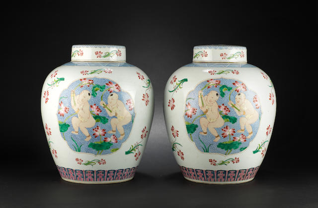 A pair of large famille rose jars and covers