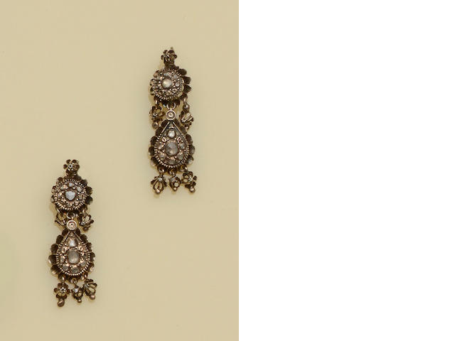 A diamond cluster ring and a pair of diamond set earpendants (2)