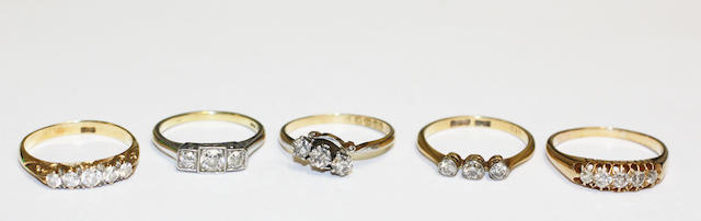 A collection of diamond set rings, (5)
