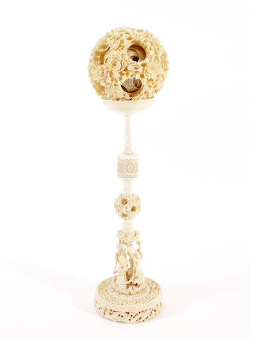 A Chinese carved ivory puzzle ball on stand