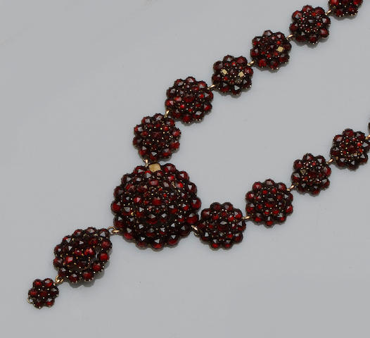 A Bohemian garnet necklace and a pair of garnet earrings (2)