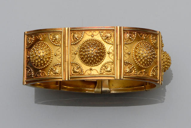 A Victorian Archaeological Revival gold panel bracelet