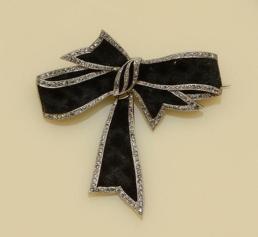A velvet and diamond set ribbon bow brooch