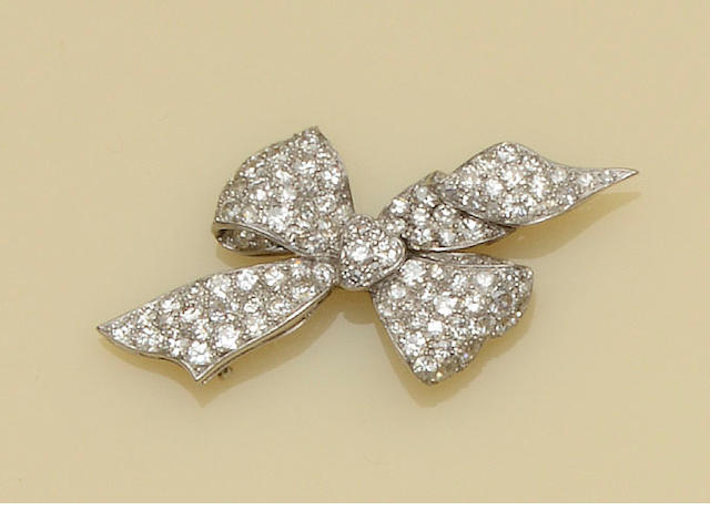A diamond ribbon bow brooch