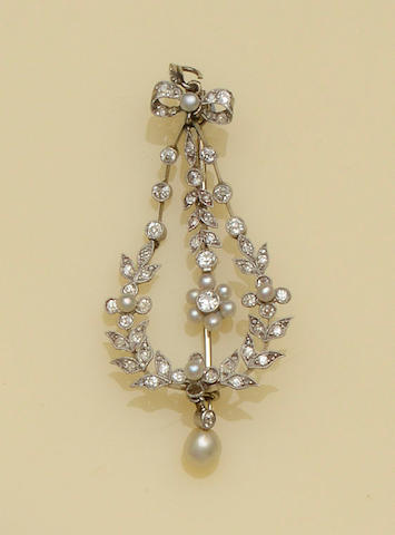 A pearl and diamond pendant/brooch