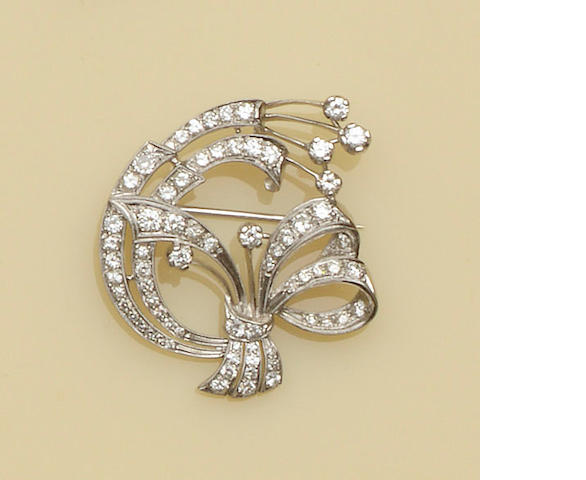 A diamond set ribbon bow brooch