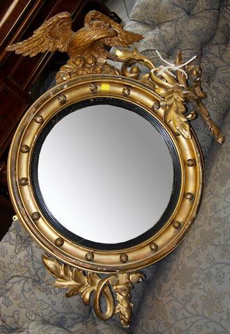 A Regency gilded convex wall mirror,