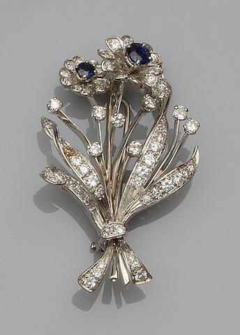 A sapphire and diamond spray brooch