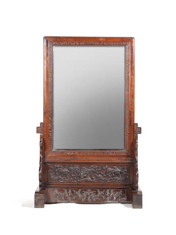 A rare and very large hardwood mirror on stand The frame Chinese 18th century, the European glass later