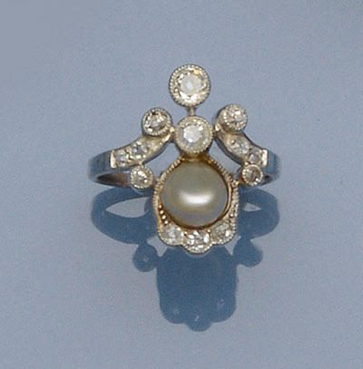 A diamond and pearl ring