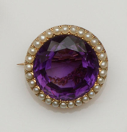 An amethyst and half pearl cluster brooch